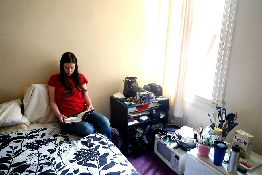 UC Berkeley public health researcher Danielle Parenteau Decker says her room in a residential hotel in San Francisco is kept too hot. Photo: Scott Strazzante, The Chronicle