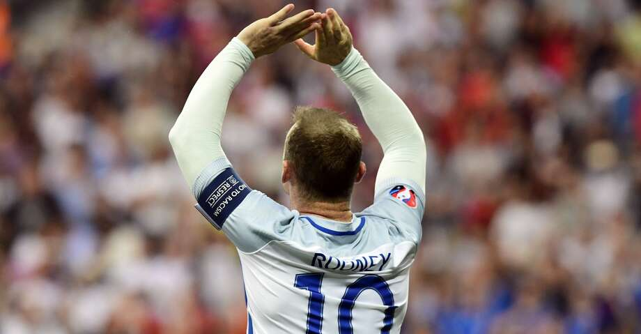 (FILES) This file photo taken on June 27, 2016 shows England's forward Wayne Rooney celebrates the team's first goal during Euro 2016 round of 16 football match between England and Iceland at the Allianz Riviera stadium in Nice on June 27, 2016.   England's record goalscorer Wayne Rooney announced on August 23, 2017 he is retiring from international football with immediate effect, despite England manager Gareth Southgate telling him he had earned a recall. / AFP PHOTO / TOBIAS SCHWARZTOBIAS SCHWARZ/AFP/Getty Images Photo: TOBIAS SCHWARZ/AFP/Getty Images