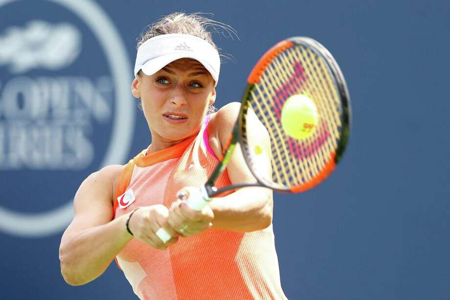 Ana Bogdan of Romania returns a shot to Kirsten Flipkens of Belgium on Wednesday at the Connecticut Open in New Haven. Photo: Maddie Meyer / Getty Images / 2017 Getty Images