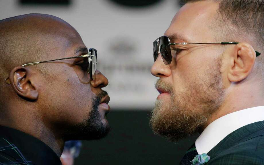 Floyd Mayweather Jr., left, and Conor McGregor pose for photographers during a news conference Wednesday, Aug. 23, 2017, in Las Vegas. The two are scheduled to fight in a boxing match Saturday in Las Vegas. (AP Photo/John Locher) Photo: John Locher, STF / Copyright 2017 The Associated Press. All rights reserved.
