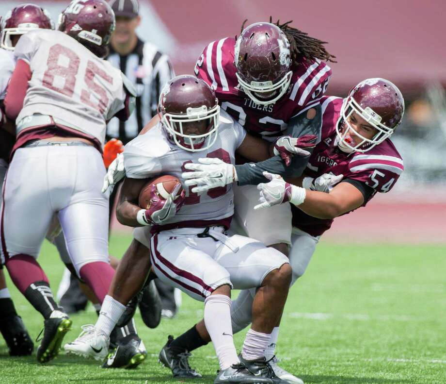 TSU RB Brad Woodard (19) is stopped by the TSU Aaron Cuevas (82) and Julian Marcantel (54) during a scrimmage on the field during the TSU Spring Football at Durley Stadium, Saturday, April 15, 2017, in Houston. (Juan DeLeon/for the Houston Chronicle ) Photo: Juan DeLeon, FRE / Houston Chronicle