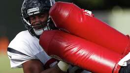 Texans defensive end Christian Covington hits a pair of blocking pads during training camp at The Methodist Training Center on Aug. 22, 2017, in Houston.