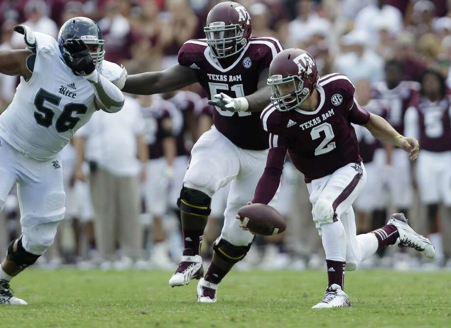 Texas A&M's Johnny Manziel (2) is pressured by Rice's Christian Covington (56) during the third quarter on Aug. 31, 2013, in College Station. Photo: Eric Gay /Associated Press / AP