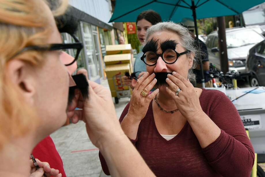 Isobel White tries on the Groucho Marx disguise she plans to wear to ridicule right-wing demonstrators in Berkeley Sunday. Photo: Michael Short, Special To The Chronicle