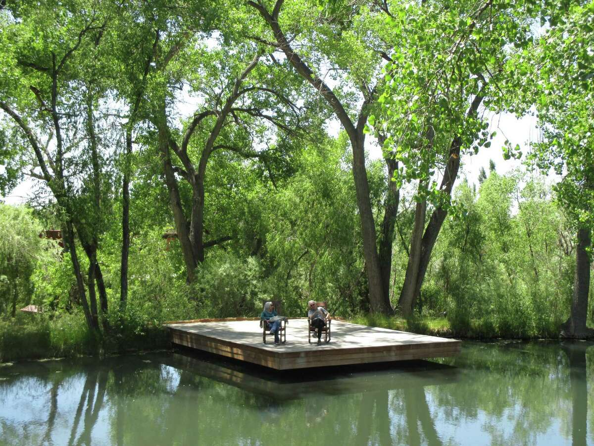 For total relaxation, rock on a dock that overlooks the stream and natural springs at Sunrise Springs Spa Resort near Santa Fe, New Mexico.