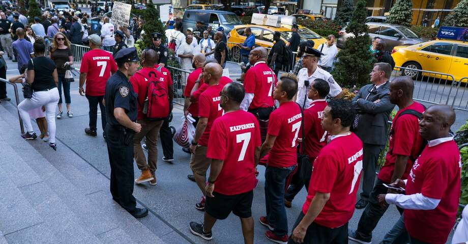 People arrive for a rally in support of unsigned NFL quarterback Colin Kaepernick on Wednesday, Aug 23, 2017, near NFL headquarters in New York. (AP Photo/Craig Ruttle) Photo: Craig Ruttle/Associated Press