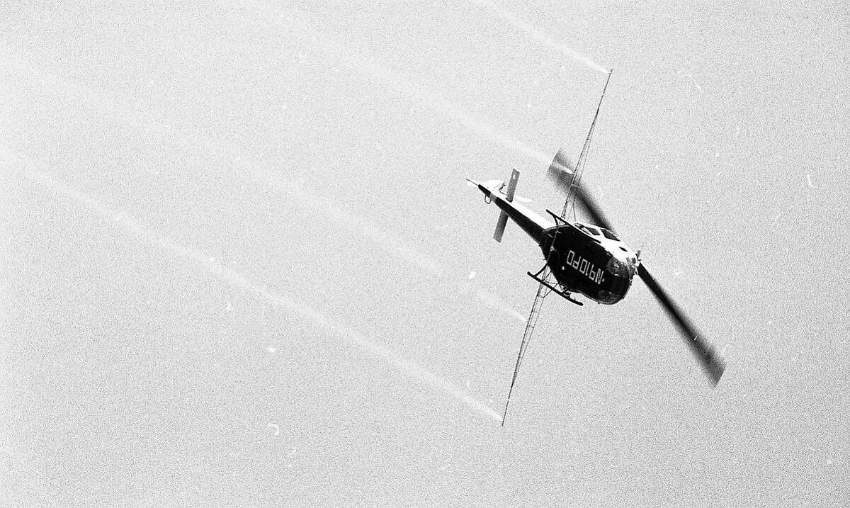 Aerial spraying of pesticide Malathion over Portola Valley area, July 20, 1981