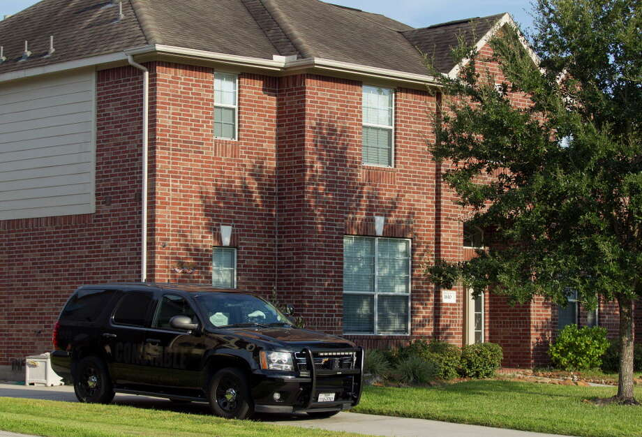 A deputy's vehicle with the Montgomery County Precinct 3 Constable's Office is seen at a home in the 1600 block of Julia Park Lane where nine children were taken after the mother and father were arrested and charged with child endangerment, Wednesday, Aug. 23, 2017, in Spring. One child was transported to Texas ChildrenÕs Hospital, while the other eight were put into custody of Child Protective Services. Photo: Jason Fochtman, Houston Chronicle / © 2017 Houston Chronicle