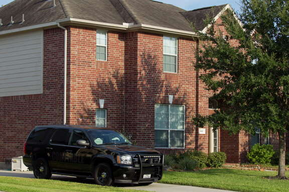 A deputy's vehicle with the Montgomery County Precinct 3 Constable's Office is seen at a home in the 1600 block of Julia Park Lane where nine children were taken after the mother and father were arrested and charged with child endangerment, Wednesday, Aug. 23, 2017, in Spring. One child was transported to Texas ChildrenÕs Hospital, while the other eight were put into custody of Child Protective Services.