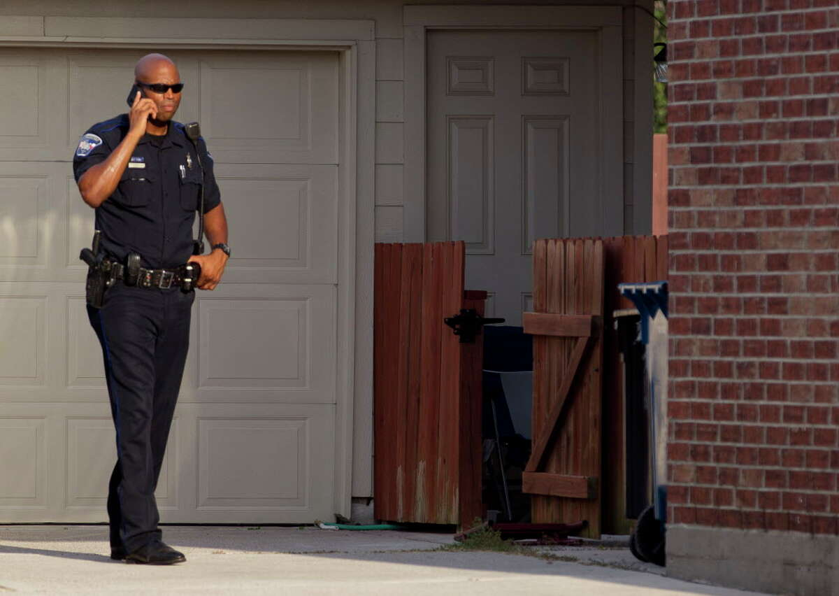 An deputy with the Montgomery County Precinct 3 Constable's Office is seen at a home in the 1600 block of Julia Park Lane where nine children were taken after the mother and father were arrested and charged with child endangerment, Wednesday, Aug. 23, 2017, in Spring. One child was transported to Texas Children?•s Hospital, while the other eight were put into custody of Child Protective Services.