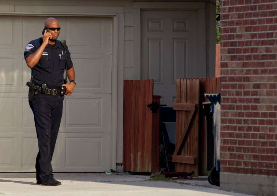 An deputy with the Montgomery County Precinct 3 Constable's Office is seen at a home in the 1600 block of Julia Park Lane where nine children were taken after the mother and father were arrested and charged with child endangerment, Wednesday, Aug. 23, 2017, in Spring. One child was transported to Texas ChildrenÕs Hospital, while the other eight were put into custody of Child Protective Services. Photo: Jason Fochtman, Houston Chronicle / © 2017 Houston Chronicle