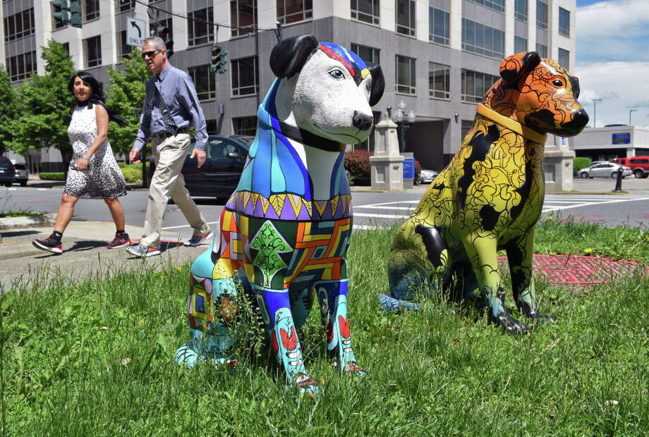 "The first two of 20 3-foot-tall statues of Nipper as part of ""Downtown is Pawsome,"" outside the Albany Center Gallery Friday June 9, 2017 in Albany, NY.  (John Carl D'Annibale / Times Union) Photo: John Carl D'Annibale / 40040734A"