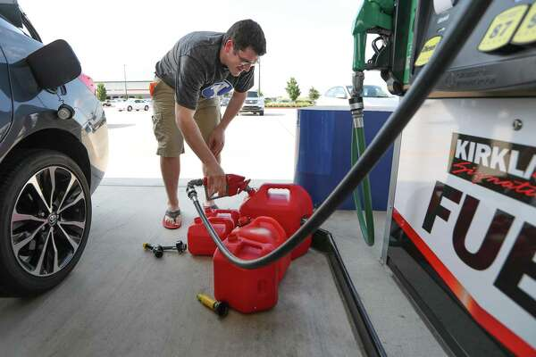 """Chris Mathew fills his vehicle and five gas cans at Costco in preparation for Tropical Storm Harvey Wednesday, Aug. 23, 2017, in Pearland. Mathew is an administrator at the Lyndon B. Johnson Hospital and would be required to make it to the hospital is needed. """"It's better to be prepared than not"""" Mathew said after filling up his cans. ( Steve Gonzales  / Houston Chronicle )"""