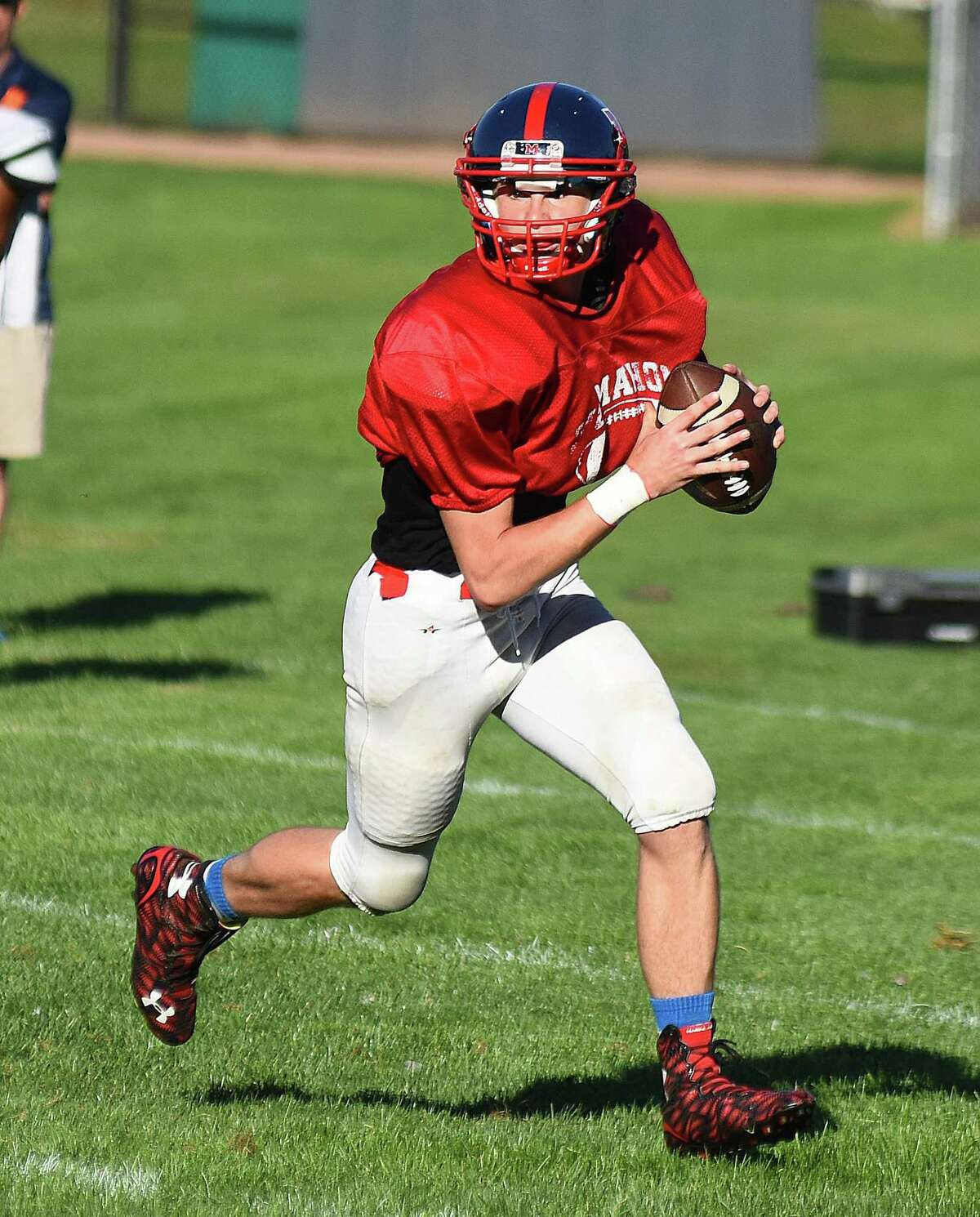 Brien McMahon quarterback Tyler Holloran scrambles out of the pocket while looking to pass during the Senators game against Norwalk in the Wilton Football Jamboree on Wednesday. Seven teams took part in the annual affair.