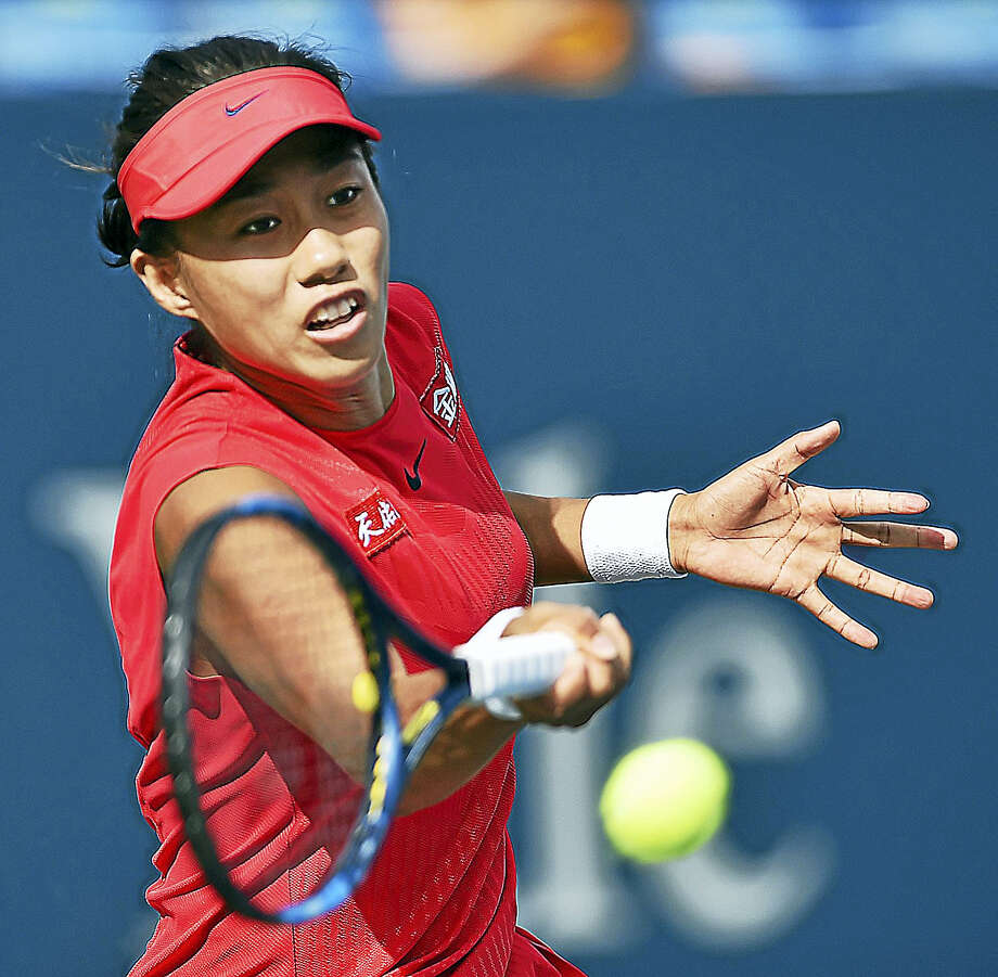 China's Shuai Zhang returns a volley against Magda Linette on Wednesday afternoon. Photo: Catherine Avalone/Hearst Connecticut Media / New Haven Register