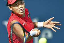 China's Shuai Zhang returns a volley against Magda Linette on Wednesday afternoon.