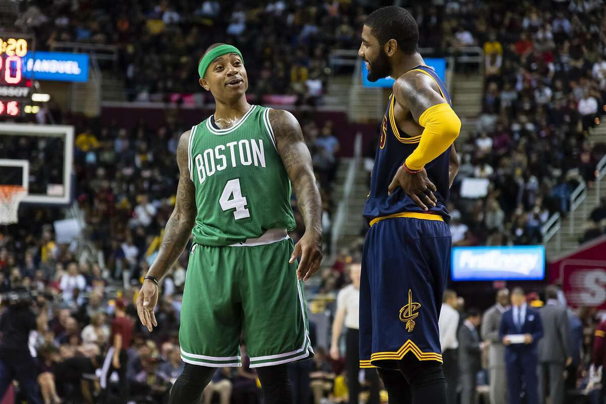 Isaiah Thomas #4 of the Boston Celtics and Kyrie Irving #2 of the Cleveland Cavaliers talk on the court during the first half at Quicken Loans Arena on November 3, 2016 in Cleveland, Ohio.