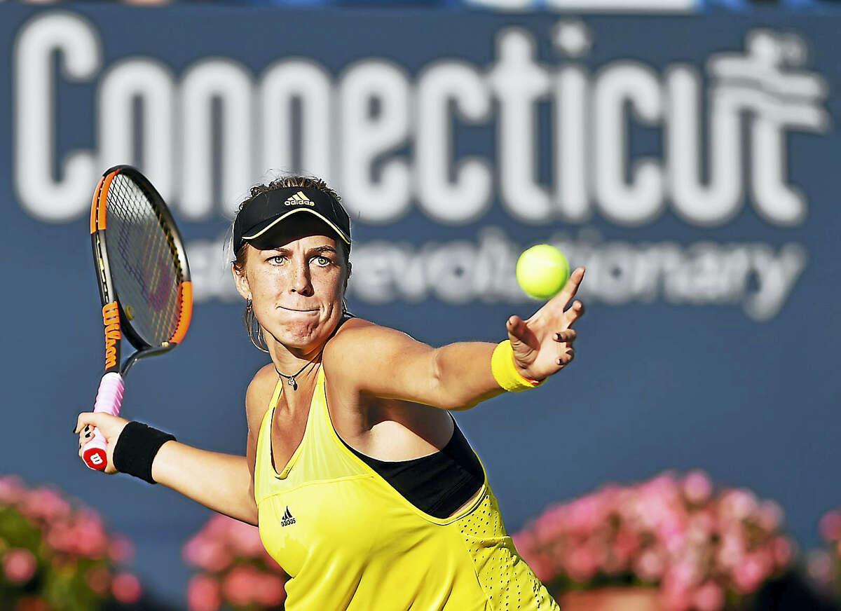 Russia's Anastasia Pavlyuchenkova returns a volley against Carla Suarez Navarro on Wednesday.
