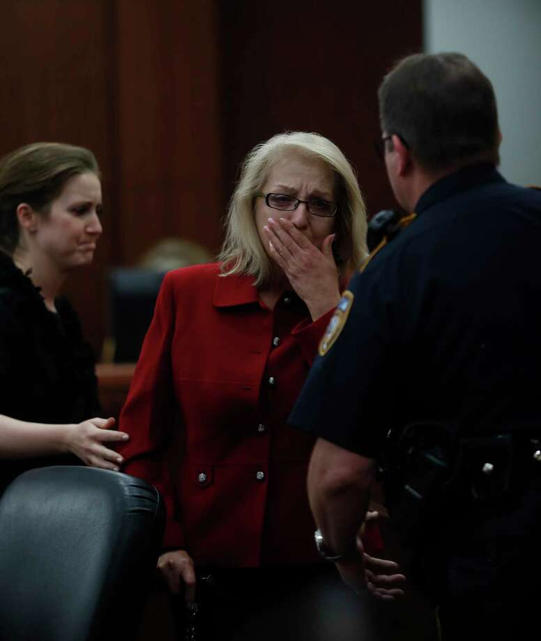 Sandra Melgar reacts after jurors convicted her of murder in the death of her husband. She faces five years to life in prison. Photo: Karen Warren, Staff Photographer / @ 2017 Houston Chronicle