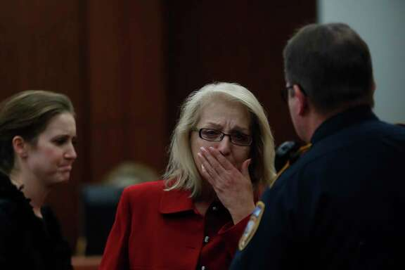 Sandra Melgar reacts after jurors convicted her of murder in the death of her husband. She faces five years to life in prison.