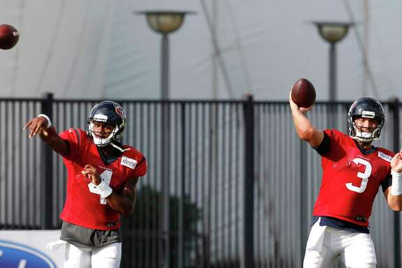 Houston Texans quarterbacks Deshaun Watson (4) and  Tom Savage (3) throw passes during training camp at The Methodist Training Center on Tuesday, Aug. 22, 2017, in Houston. ( Brett Coomer / Houston Chronicle )