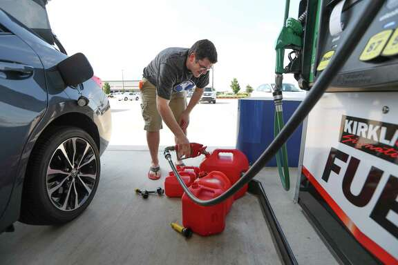 "Chris Mathew fills his vehicle and five gas cans at Costco in preparation for Tropical Storm Harvey Wednesday, Aug. 23, 2017, in Pearland. Mathew is an administrator at the Lyndon B. Johnson Hospital and would be required to make it to the hospital is needed. ""It's better to be prepared than not"" Mathew said after filling up his cans."