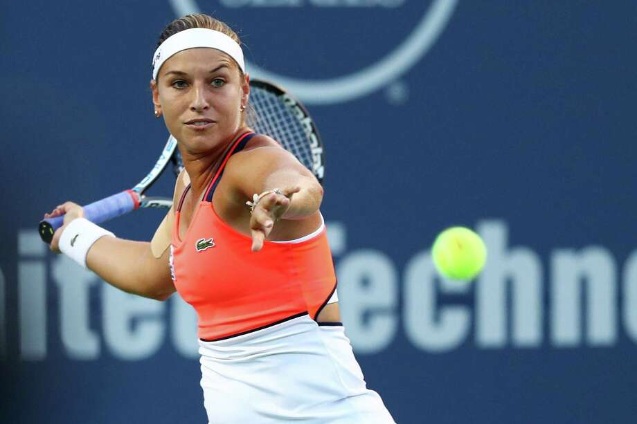 Dominika Cibulkova of Slovakia returns a shot to Alize Cornet of France on Wednesday night in New Haven at the Connecticut Open. Photo: Maddie Meyer / Getty Images / 2017 Getty Images