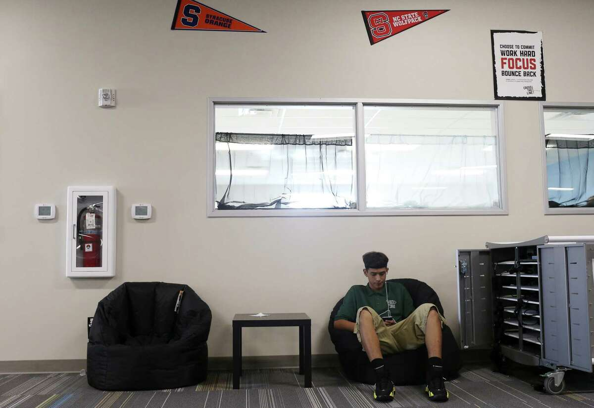 Carpe Diem Innovative School-Westwood student Matthew Guerra, 15, relaxes on a bean chair in the High School Learning Center, Tuesday, August 22, 2017.