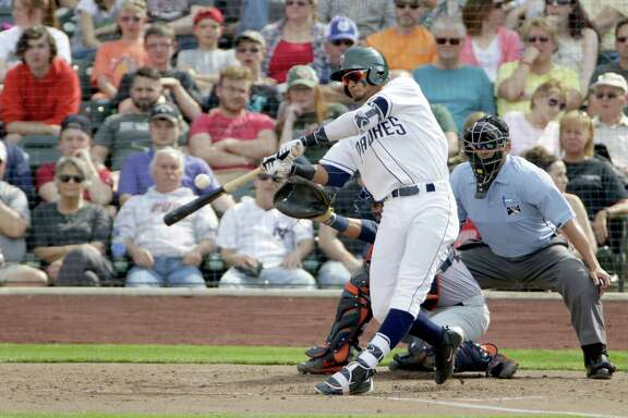 Shortstop Fernando Tatis Jr., connecting at the plate during spring training, is one of the San Deigo Padres' top prospects. His father played in the majors and Tatis Jr. made his debut with the Double-A Missions on Aug. 22, 2017.