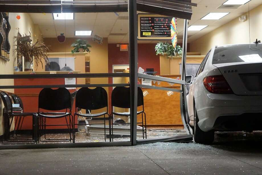 A car chose the wrong gear and drove into a hair salon instead of out of a parking lot on the South Side Wednesday, Aug. 23, 2017. Photo: Jacob Beltran