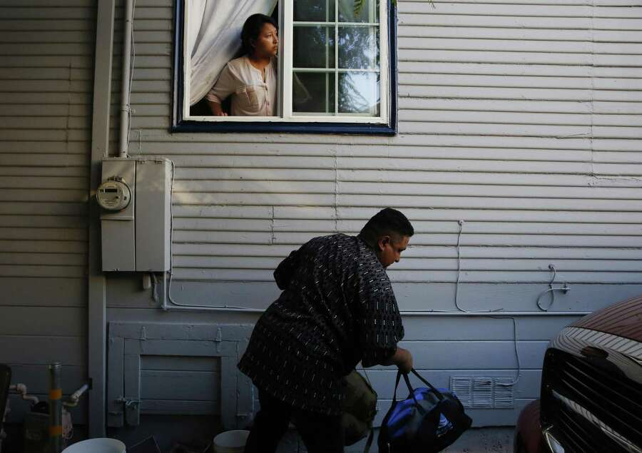 Melin Sanchez, 21, helps her father Eusebio pack the car at their home in Oakland before he and his wife fly to Mexico on August 16, 2017. Federal immigration officials denied Eusebio and his wife's request for a deportation delay. Photo: Leah Millis / The Chronicle / Leah Millis/ The Chronicle