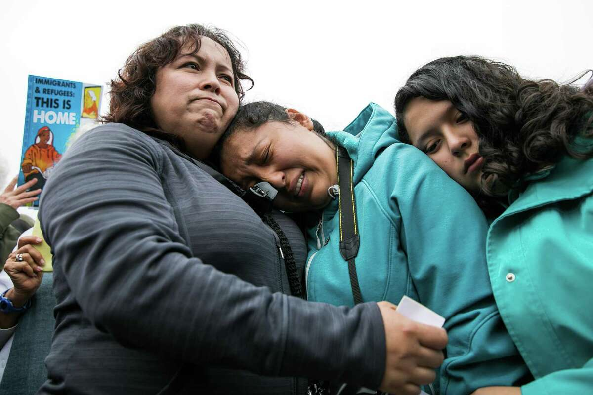 Highland Hospital Nurse Maria Mendoza-Sanchez (left) comforts her daughters Melin Sanchez, 21 (center), and Elizabeth Sanchez, 16, at Highland Hospital in Oakland during a rally and demonstration in support of Ms. Mendoza-Sanchez and her family on Monday, August 14, 2017. Mrs. Mendoza-Sanchez and her husband may have to return to Mexico after their request their request for a stay of deportation was denied.