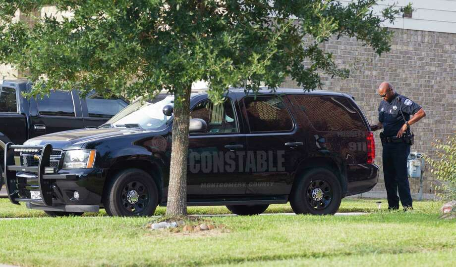 An deputy with the Montgomery County Precinct 3 Constable's Office is seen at a home in the 1600 block of Julia Park Lane where nine children were taken after the mother and father were arrested and charged with child endangerment, Wednesday, Aug. 23, 2017, in Spring. One child was transported to Texas Childrené•s Hospital, while the other eight were put into custody of Child Protective Services. Photo: Jason Fochtman, Staff Photographer / © 2017 Houston Chronicle