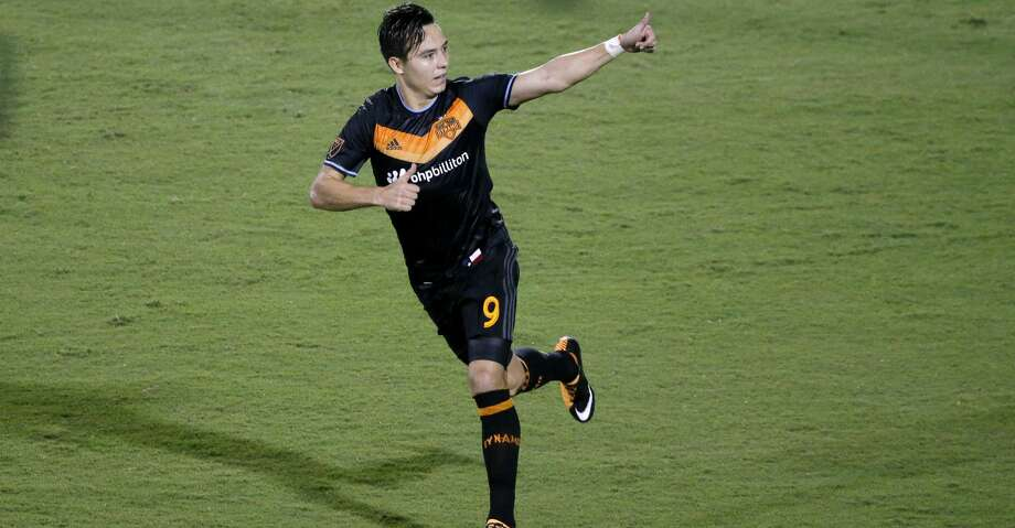 Houston Dynamo forward Erick Torres (9) celebrates in the direction of fans after scoring against FC Dallas in the second half of an MLS soccer game, Wednesday, Aug. 23, 2017, in Frisco, Texas. Torres had two goals in the 3-3 tie. (AP Photo/Tony Gutierrez) Photo: Tony Gutierrez/Associated Press