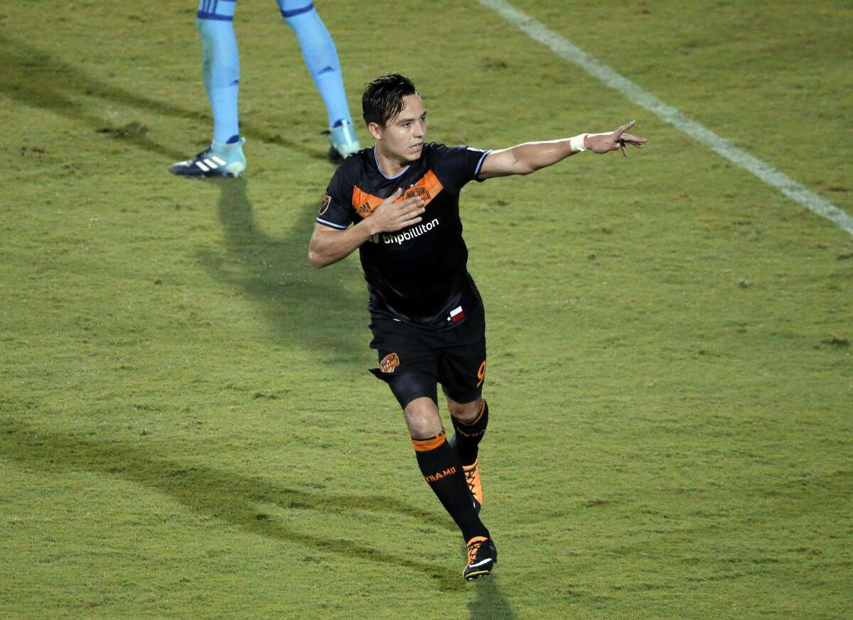 Houston Dynamo forward Erick Torres (9) celebrates in the direction of fans after scoring against FC Dallas in the second half of an MLS soccer game, Wednesday, Aug. 23, 2017, in Frisco, Texas. Torres had two goals in the 3-3 tie. (AP Photo/Tony Gutierrez)