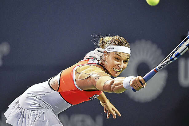 Dominika Cibulkova reaches to return a volley against Alize Cornet Wednesday in the second round of the Connecticut Open.