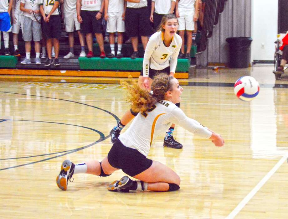 MELHS senior Madeline Stewart successfully makes a dig during the first game against Alton in Wednesday's season-opening match for the Knights.
