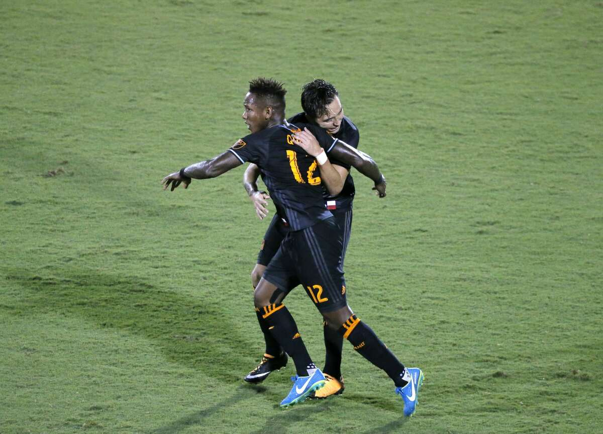 Houston Dynamo' Romell Quioto (12) and Erick Torres, rear, celebrate a goal by Torres in the second half of an MLS soccer game against FC Dallas on Wednesday, Aug. 23, 2017, in Frisco, Texas. (AP Photo/Tony Gutierrez)