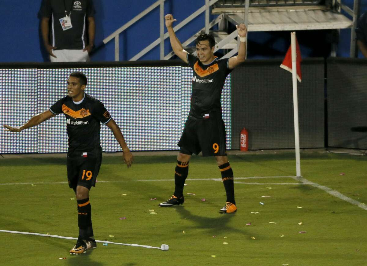 Houston Dynamo's Mauro Manotas look back up field as forward Erick Torres (9) celebrates scoring his second goal in the second half of an MLS soccer game against FC Dallas on Wednesday, Aug. 23, 2017, in Frisco, Texas. (AP Photo/Tony Gutierrez)