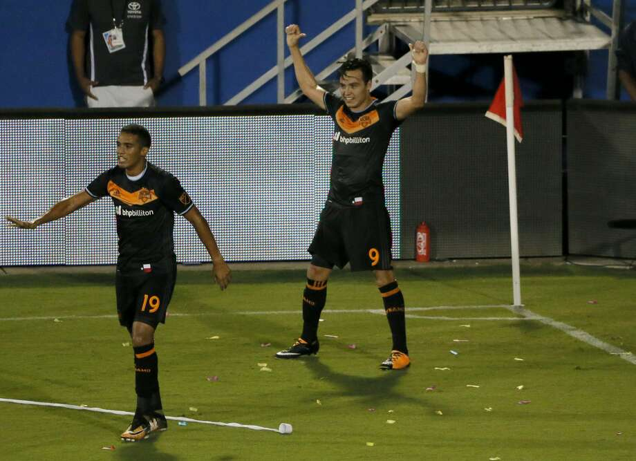 Houston Dynamo's Mauro Manotas look back up field as forward Erick Torres (9) celebrates scoring his second goal in the second half of an MLS soccer game against FC Dallas on Wednesday, Aug. 23, 2017, in Frisco, Texas. (AP Photo/Tony Gutierrez) Photo: Tony Gutierrez/Associated Press