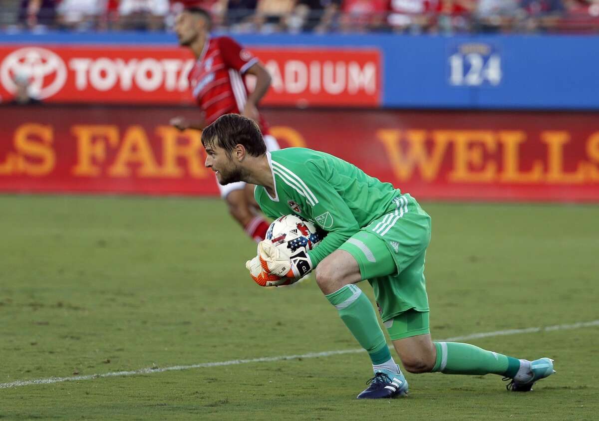 Houston Dynamo goalkeeper Tyler Deric controls a shot by FC Dallas in the first half of an MLS soccer game, Wednesday, Aug. 23, 2017, in Frisco, Texas. (AP Photo/Tony Gutierrez)