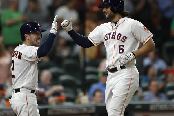 Houston Astros Jake Marisnick (6) celebrates his home run with Alex Bregman (2) in the fifth inning of an MLB baseball game at Minute Maid Park, Wednesday, Aug. 23, 2017, in Houston.  ( Karen Warren / Houston Chronicle )