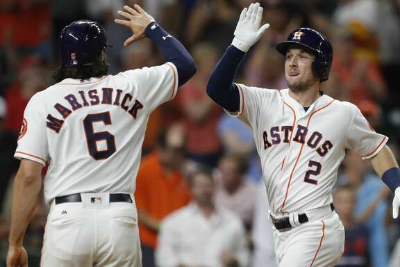 Houston Astros Alex Bregman (2) celebrates his three-run home run with Jake Marisnick (6) in the eighth inning of an MLB baseball game at Minute Maid Park, Wednesday, Aug. 23, 2017, in Houston.  ( Karen Warren / Houston Chronicle )