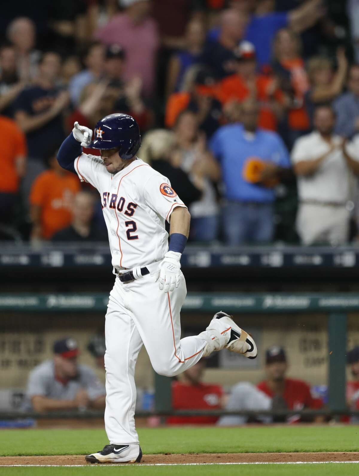 Houston Astros Alex Bregman (2) celebrates his three-run home run as he nears home plate in the eighth inning of an MLB baseball game at Minute Maid Park, Wednesday, Aug. 23, 2017, in Houston. ( Karen Warren / Houston Chronicle )