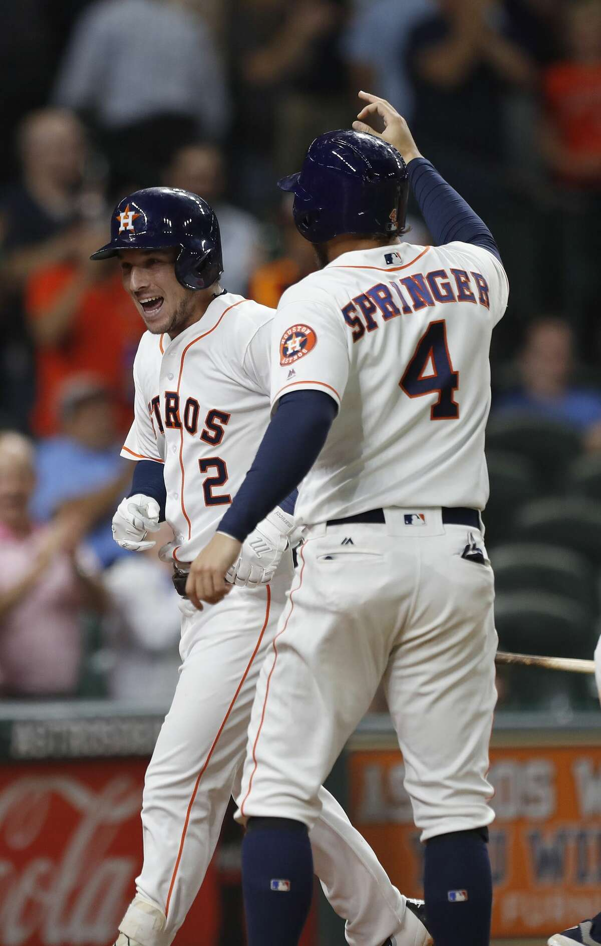 Houston Astros Alex Bregman (2) celebrates his three-run home run with George Springer (4) in the eighth inning of an MLB baseball game at Minute Maid Park, Wednesday, Aug. 23, 2017, in Houston. ( Karen Warren / Houston Chronicle )
