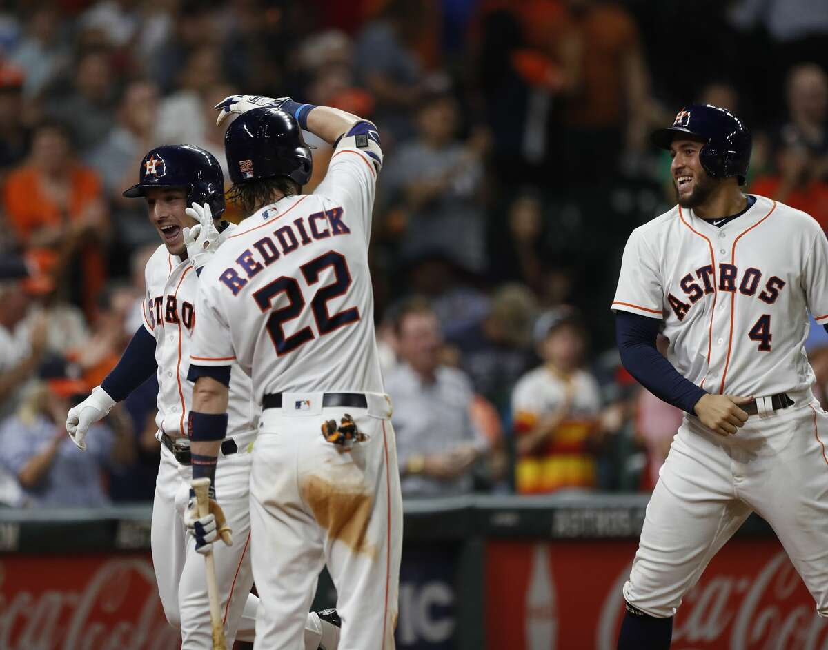 Houston Astros Alex Bregman (2) celebrates his three-run home run with Josh Reddick in the eighth inning of an MLB baseball game at Minute Maid Park, Wednesday, Aug. 23, 2017, in Houston. ( Karen Warren / Houston Chronicle )
