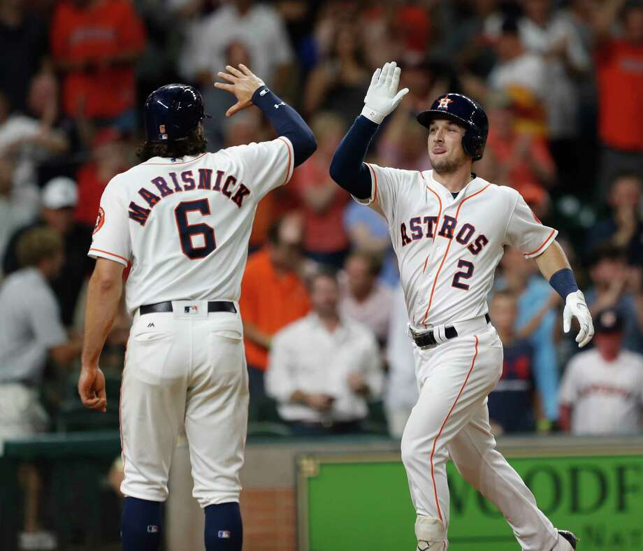 Alex Bregman, right, puts the Astros victory on ice Wednesday night with a three-run homer in the eighth that drew the appreciation of Jake Marisnick, who had homered earlier in the game. Photo: Karen Warren, Staff Photographer / @ 2017 Houston Chronicle