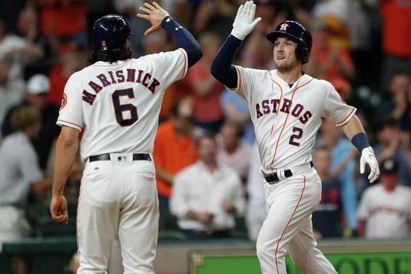 Alex Bregman, right, puts the Astros victory on ice Wednesday night with a three-run homer in the eighth that drew the appreciation of Jake Marisnick, who had homered earlier in the game.