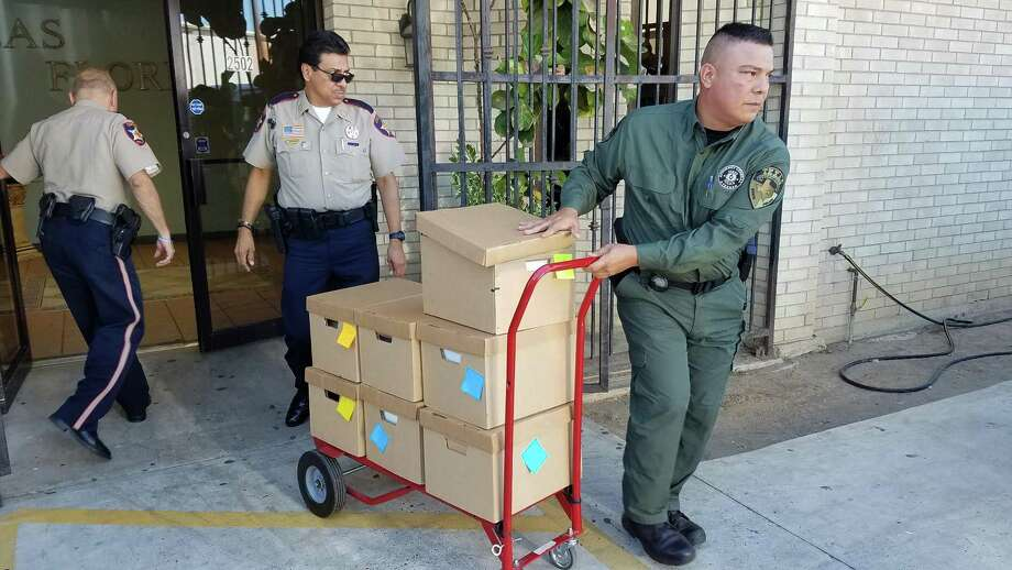 Webb County Sheriff Precinct 1 Rudy Rodriguez transfers a box of documents during a Las Flores Adult Day Care search in response to allegations of Medicaid fraud. Photo: Foto Por César G. Rodriguez, Laredo Morning Times