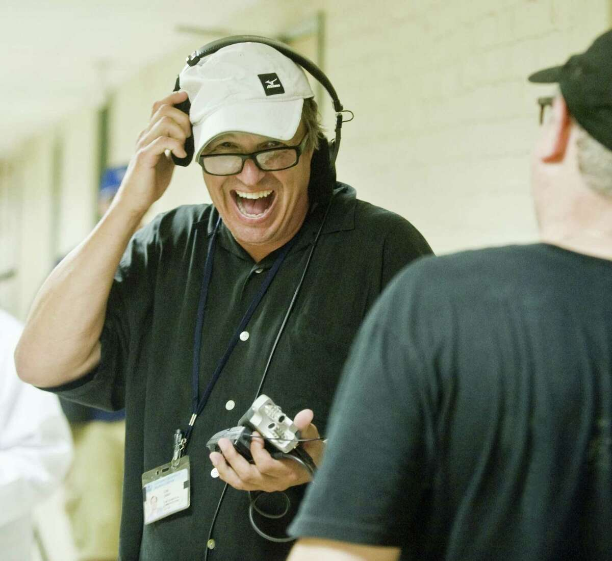 Producer Craig Dobson, of Darien, shares a laugh on the set while shooting a short film in White Hall at Western Connecticut State University in Danbury on Aug. 13.